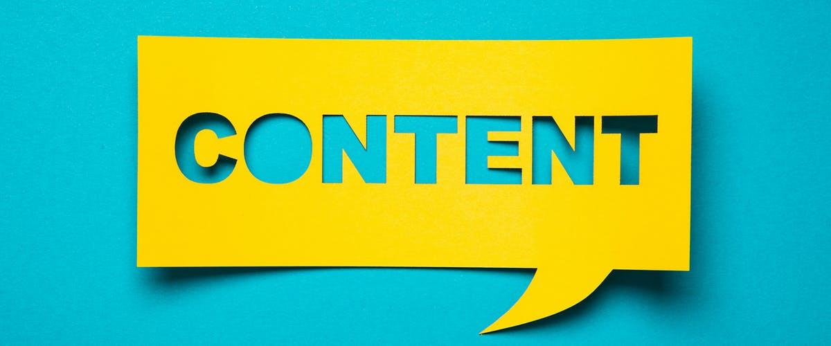 "A paper speech bubble with the word ""content"" cut out"